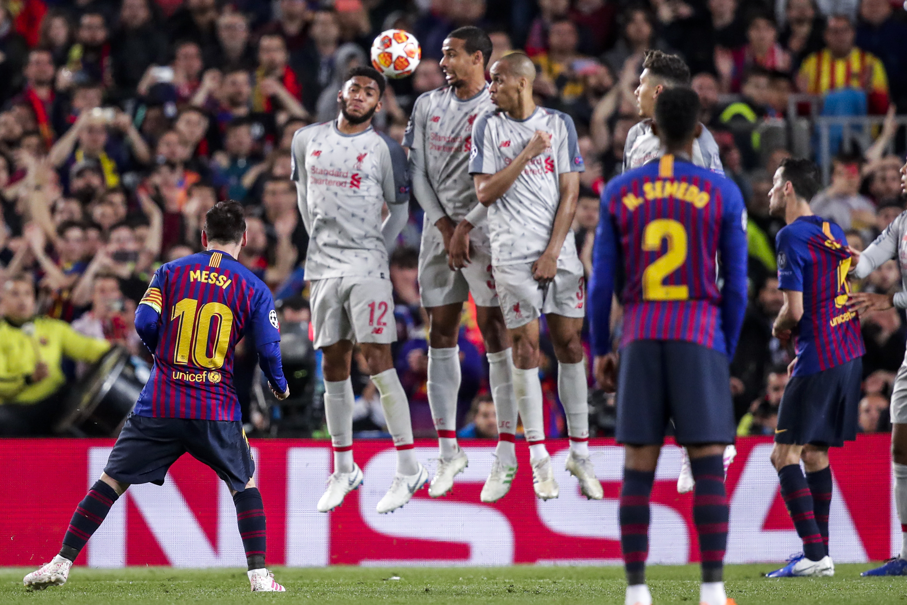 Lionel Messi's stunning free-kick goes over the Liverpool wall en route to the net to put Barca three up