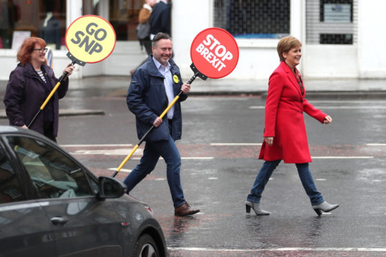 Nicola Sturgeon leads Alyn Smith MEP and Deirdre Brock MP across the road while out campaigning yesterday