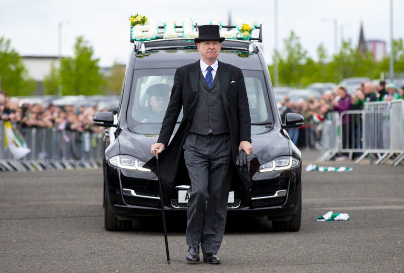 Fans gather to pay their respects as the hearse of Celtic's legendary Lisbon Lions captain Billy McNeill makes its way past Celtic Park, after his funeral on Friday