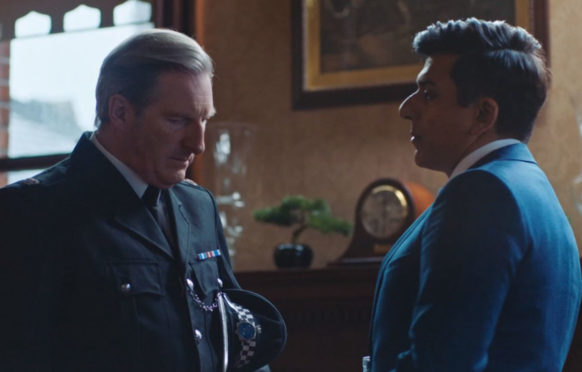 Ace Bhatti, as Rohan Sindwhani, with co-star Adrian Dunbar