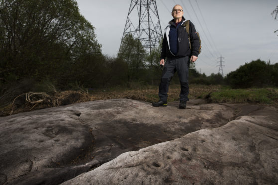 Gordon Morrison at the top of Waulking Mill Road in Faifley where there are some large rocks with cup and ring cravings possibly dating back to neolithic times…..