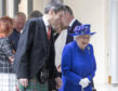 Queen Elizabeth II accompanied by Presiding Officer of the Scottish Parliament Ken Macintosh as they walk through the Garden Lobby at the Scottish Parliament in Edinburgh ahead of a ceremony marking the 20th anniversary of devolution in the Holyrood chamber. on June 29, 2019 in Edinburgh, Scotland.