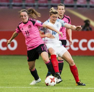 Scotland's Lisa Evans (left) holds off England's Ellen White