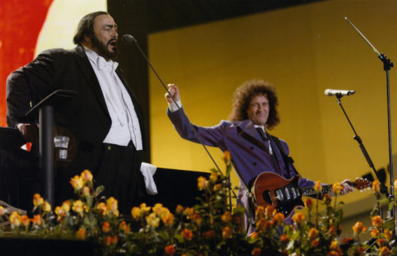 A rare duet of Pavarotti (left) and Brian May from the Pavarotti And Friends benefit concerts