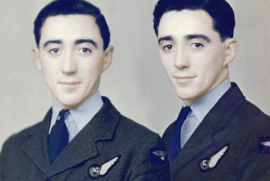 Robert Guy, left, with twin brother Charles