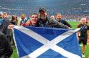 Andy Robertson celebrates winning the Champions League with boss Jurgen Klopp
