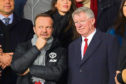 Sir Alex Ferguson next to Manchester United chief-executive Ed Woodward ahead of the UEFA Champions League Round of 16 Second Leg match between Paris Saint-Germain and Manchester United at Parc des Princes on March 06, 2019 in Paris, France.