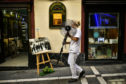 A woman carries a fan during a hot summer day in Pamplona, northern Spain