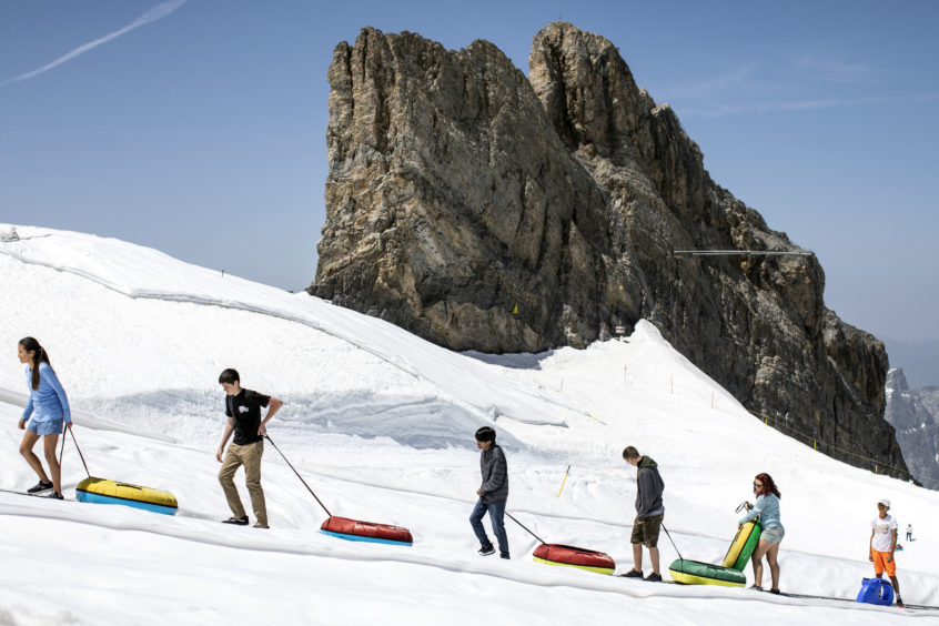 Tourists enjoy the summer temperatures on the Titlis mountain near Engelberg, Switzerland