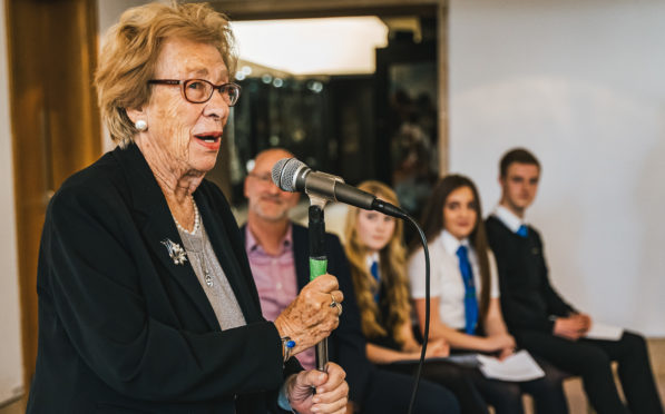Eva talks at the opening of the exhibition