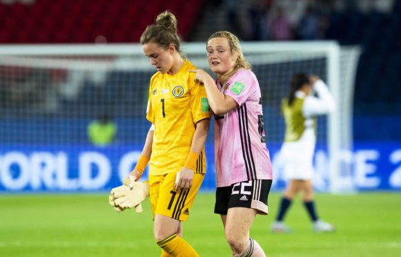 Scotland's Lee Alexander (L) and Erin Cuthbert looking dejected at full-time as they crash out of the World Cup