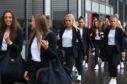 Scotland's Rachel Corsie (centre) arrives at Edinburgh Airport as the Scotland Women's team depart for the Women's World Cup in France.