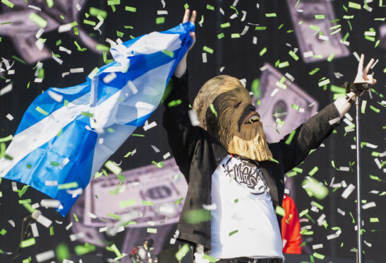 Lewis Capaldi on the Main Stage wearing a Chewbacca during the TRNSMT festival at Glasgow Green, Scotland. The signed mask has raised more than £5,000 for charity just 12 hours after going up for auction on Ebay.