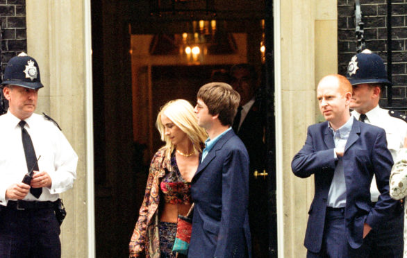 Alan McGee, on right, with Noel Gallagher and Meg Matthews arriving in Downing Street on July 30, 1997