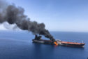An oil tanker on fire in the sea of Oman last month