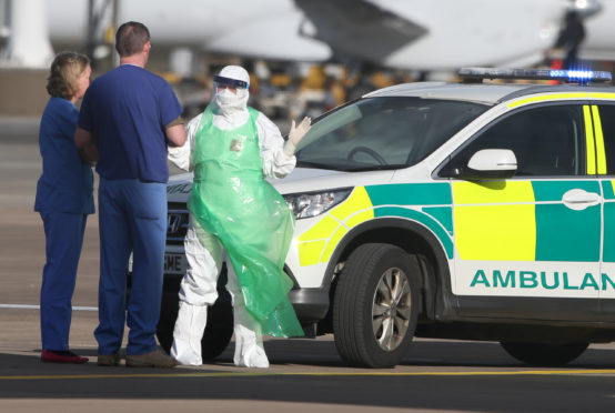 Medics after transfering nurse Pauline Cafferkey onto an RAF Hercules aircraft at Glasgow Airport before she is flown to London for treatment at the Royal Free Hospital after contracting Ebola.