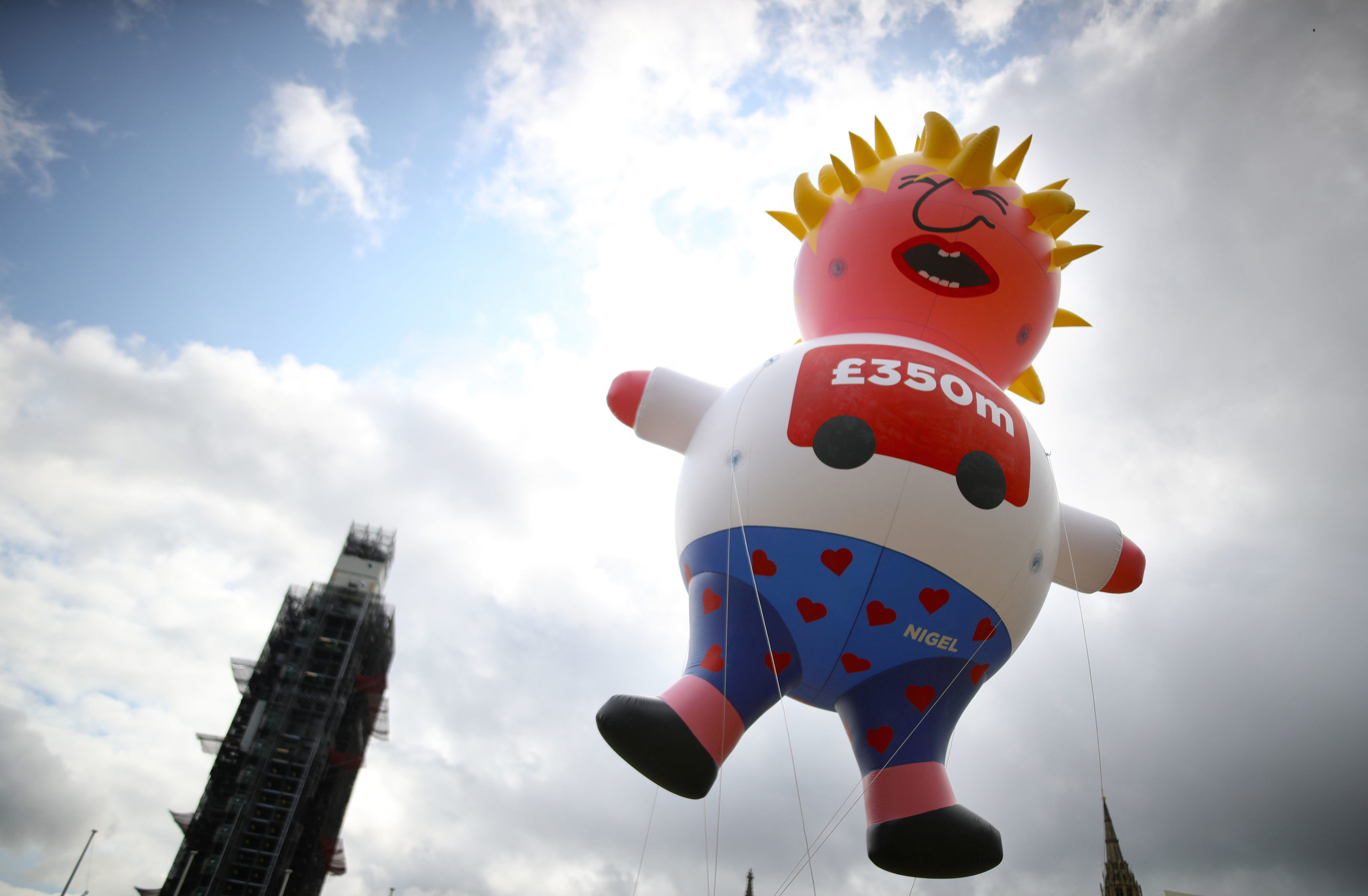 A blimp depicting Boris Johnson is launched in Parliament Square, London, ahead of a pro-European Union a march organised by March for Change.