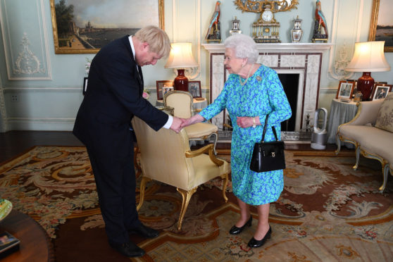 The Queen invites Boris Johnson to become Prime Minister and form a new government