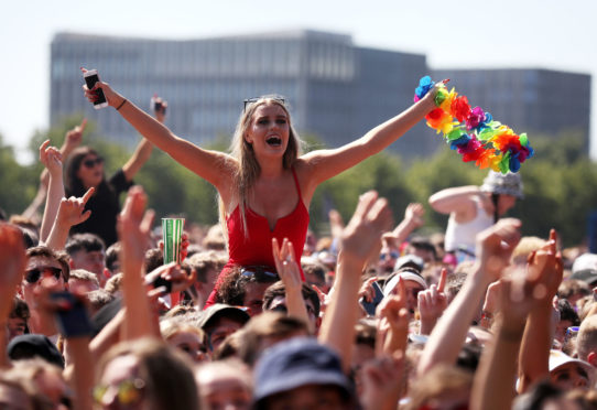 Music fans by the main stage at TRNSMT festival on Glasgow Green in Glasgow.