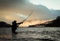 An angler at the mouth of the River Tay in Kenmore, Scotland, on the opening day of the salmon fishing season.