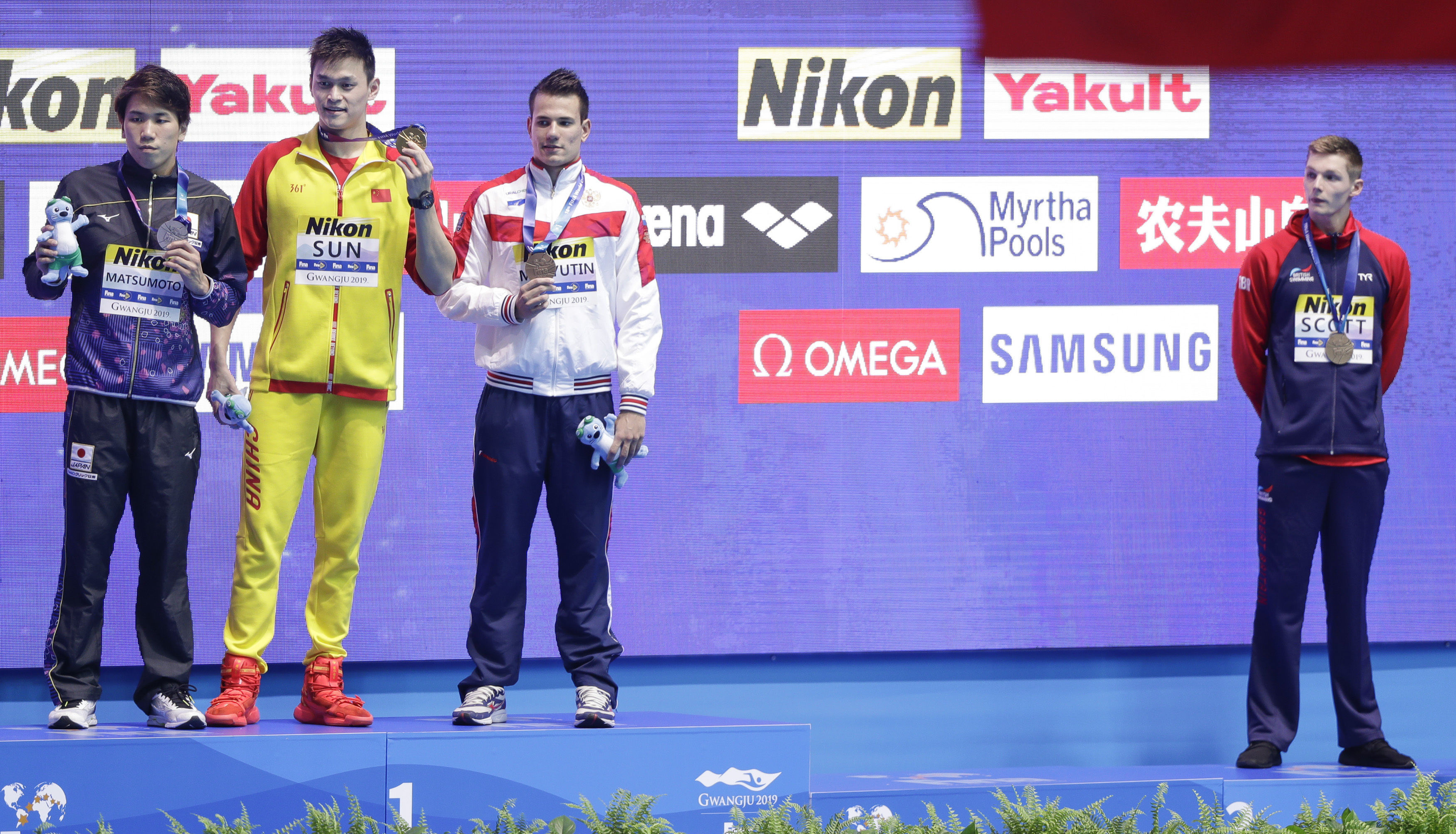 Duncan Scott, right stood away from the podium after the 200m freestyle
