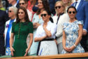 The Duchess of Cambridge and The Duchess of Sussex with Pippa Matthews on day twelve of the Wimbledon Championships at the All England Lawn Tennis and Croquet Club, Wimbledon.