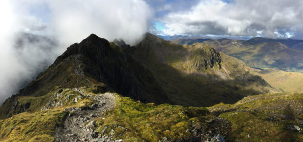 Panoramic view of the notoriously difficult Aonach Eagach mountain ridge in the Scottish Highlands.