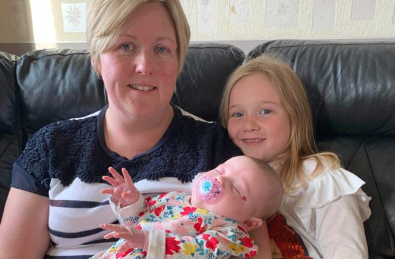 Sarah with daughters Isla and Emily Jane