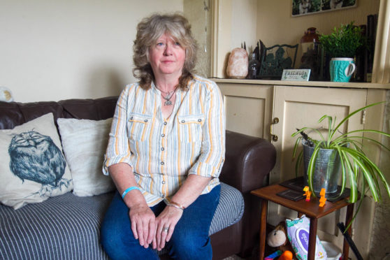 Tracy Mackey, 56, had an aneurysm and was diagnosed by accident when she contracted pneumonia and whooping cough
