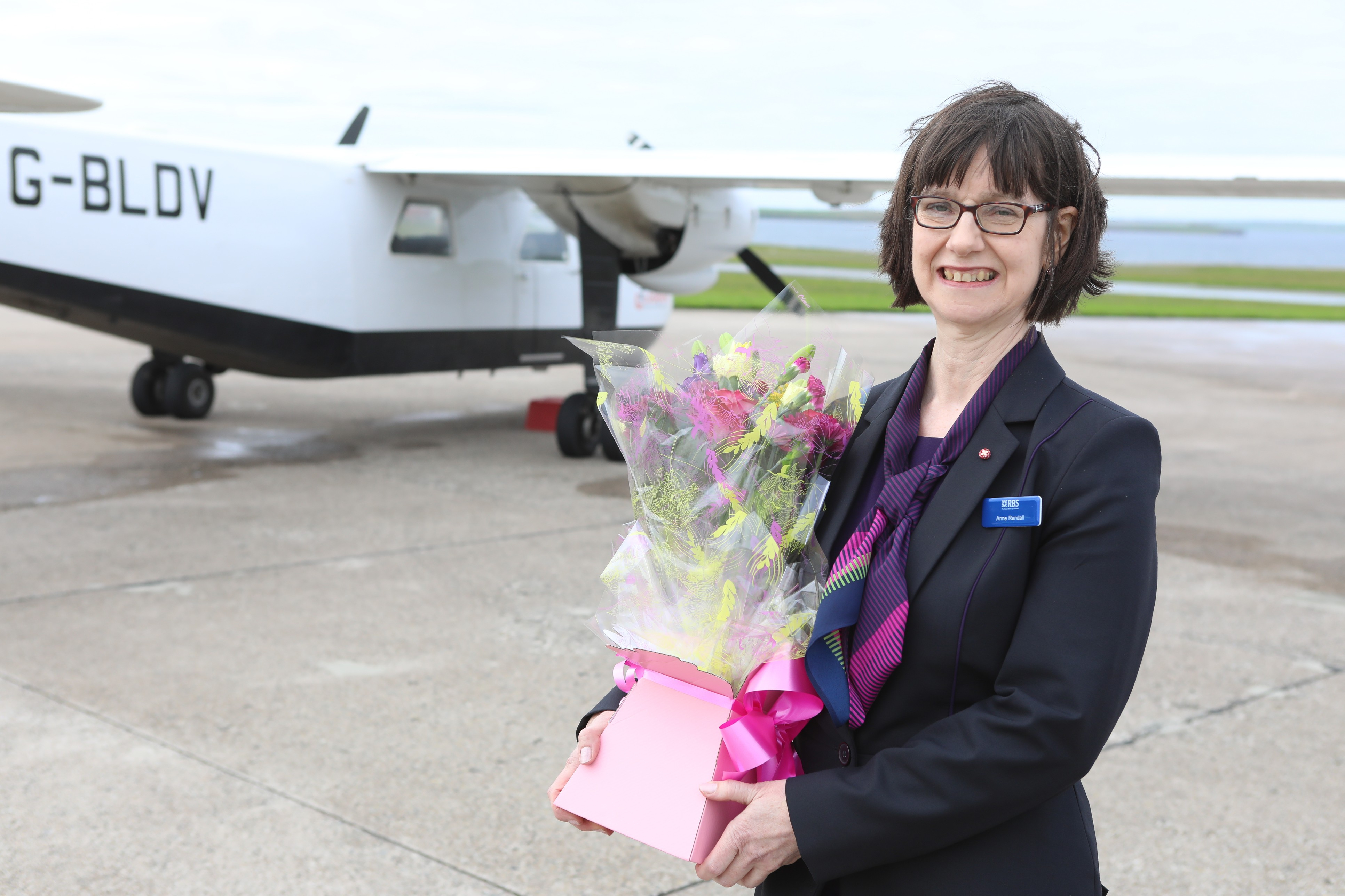 Anne Rendall with her gift as she celebrates retiring