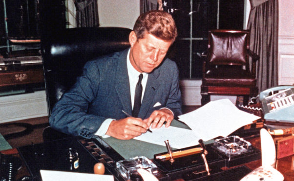 JFK kept the coconut that saved his life on his Oval Office desk