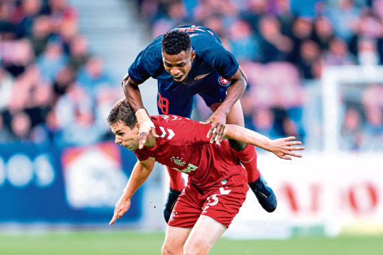 Jon Flanagan in action for Rangers in Europe