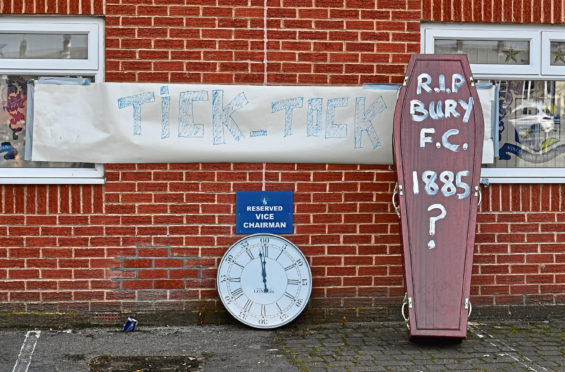 Bury fans deliver a symbolic coffin reading 'R.I.P Bury F.C. 1885 ?' and clock at Gigg Lane, home of Bury FC.