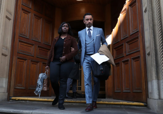 Kadijatu Johnson sister of Sheku Bayoh with lawyer Aamer Anwar as they arrive to speak to the media outside the Crown Office in Edinburgh. The family earlier met with Lord Advocate James Wolffe QC to hear his decision over prosecutions for the death of Mr Bayoh in police custody in 2015.