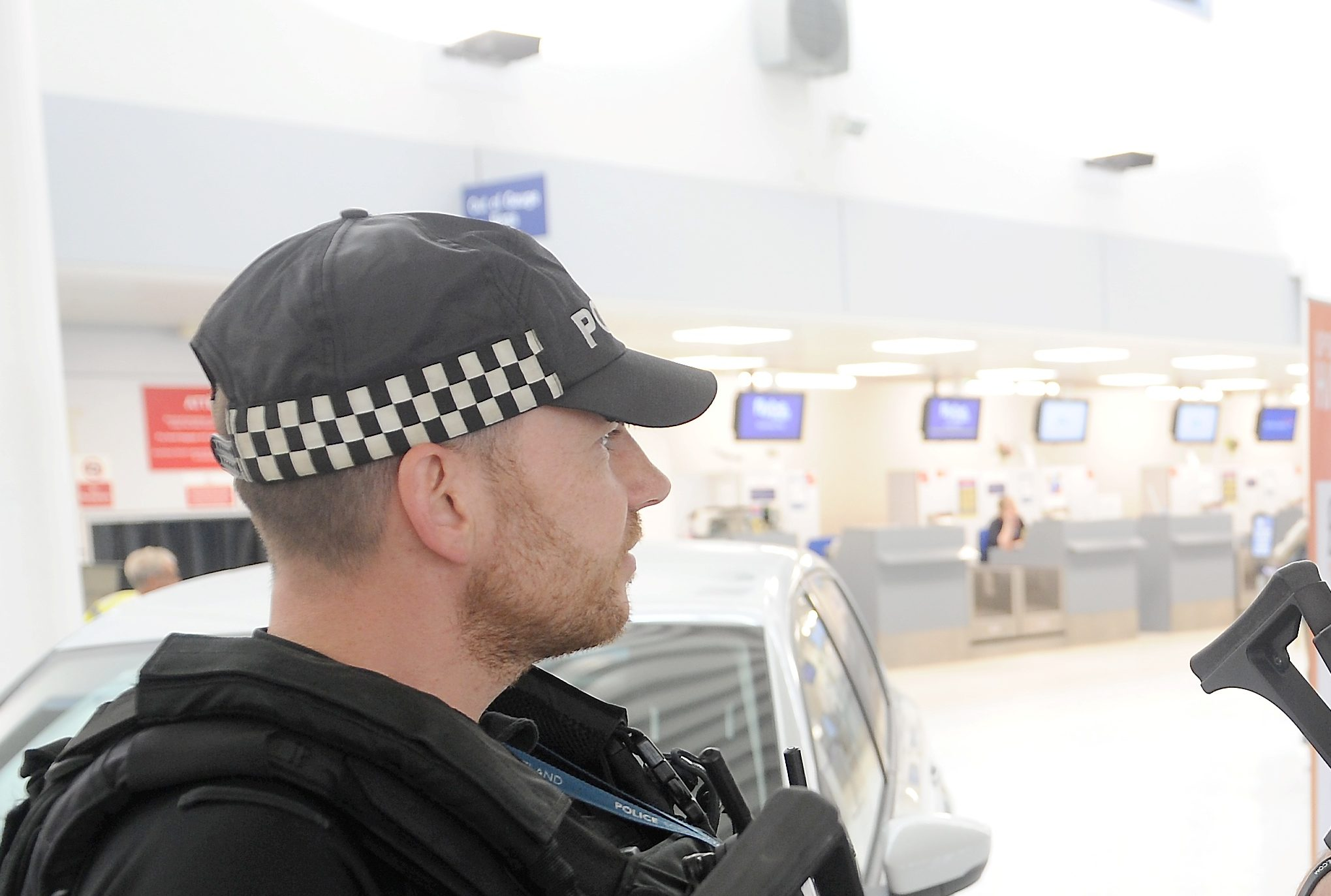 Armed Police wear unisex baseball caps.