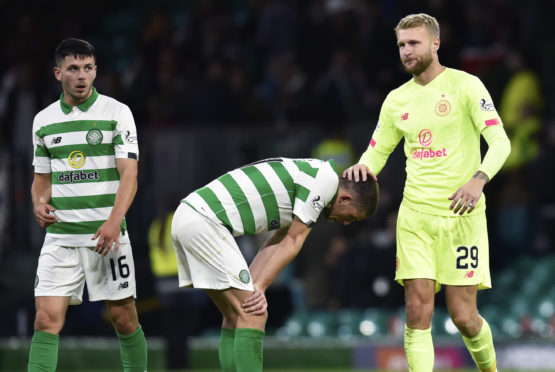 Celtic's Lewis Morgan, Ryan Christie and Scott Bain are left dejected at full-time