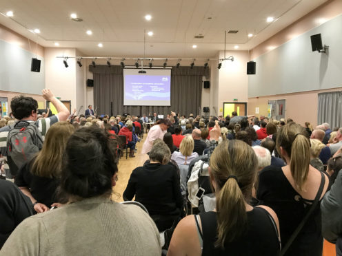 Parents pack into a public meeting at St Ambrose High in June when council and health board faced fierce criticism over handling of crisis