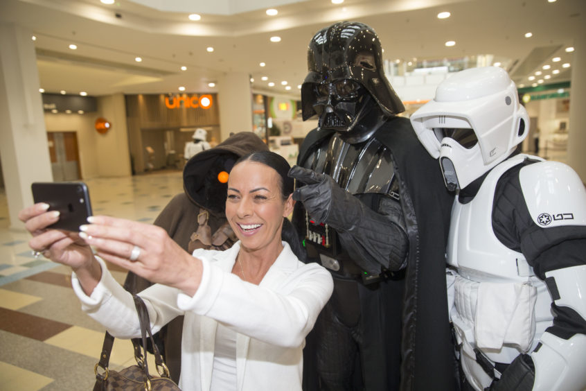 Debbie O'Neil, aged 45, from Paisley gets a selfie with Darth Vader