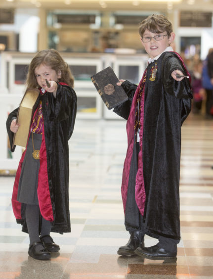 Hogwarts pupils Arya Sneddon, aged five, from Livingston and her eight-year-old brother, Rory