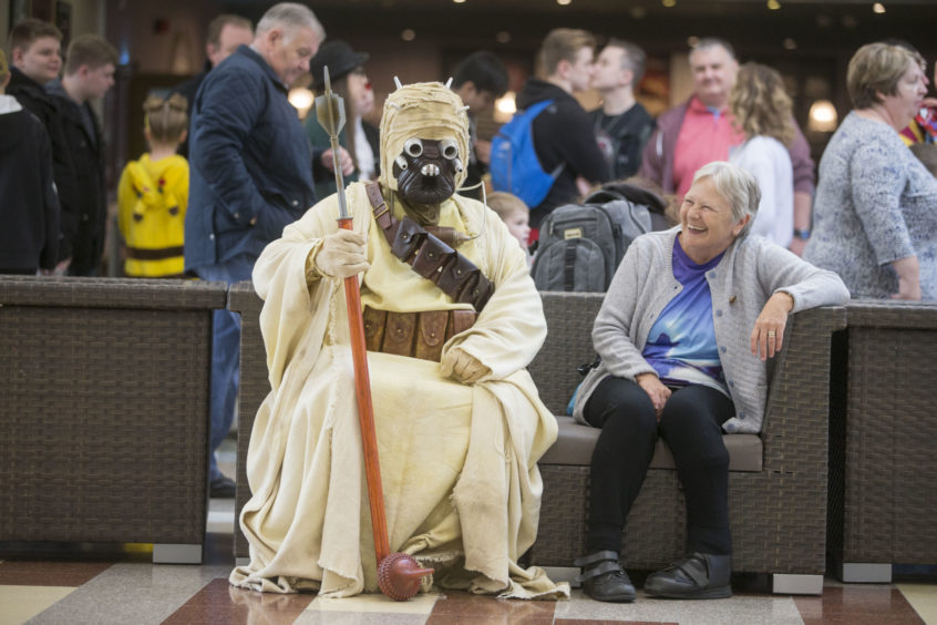 Sylvia Doe, aged 61, from Airdrie has a chat with a Sandtrooper