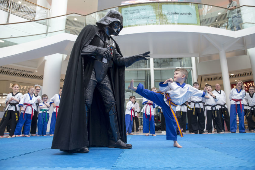 Evan Young, aged six, from Carluke uses his martial arts skills against the evil Darth Vader