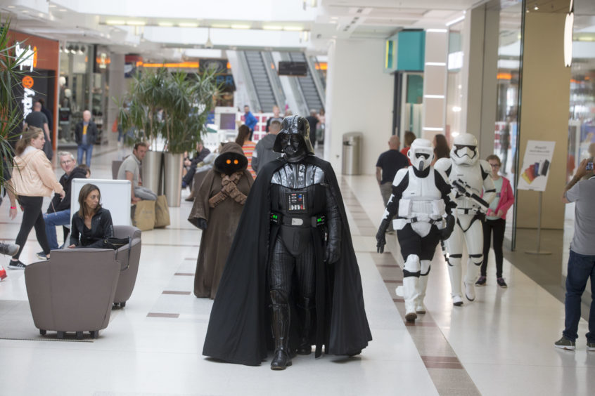 Darth Vader and his Stormtroopers have a walk round the shops