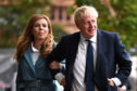 Boris Johnson and his girlfriend Carrie Symonds arrive at the Conservative Party conference yesterday