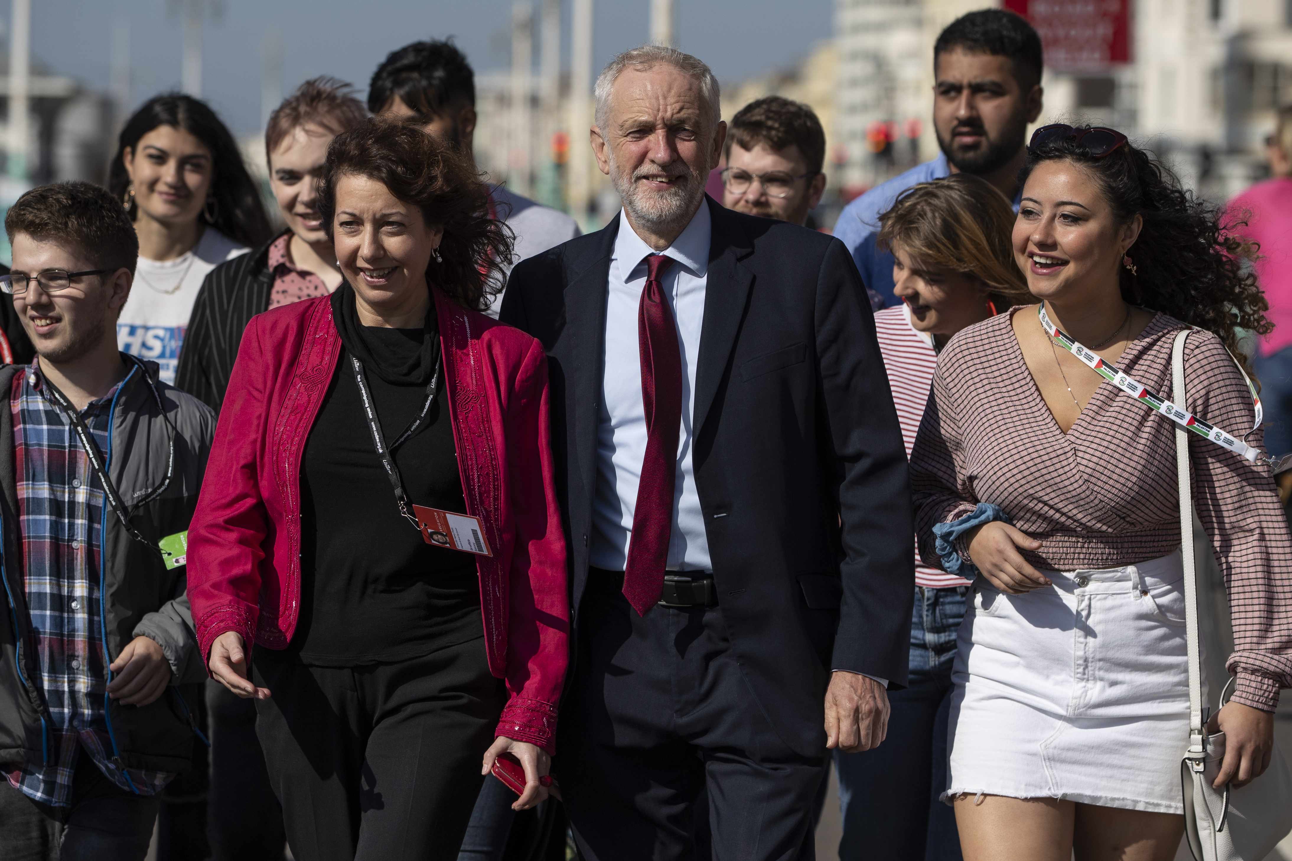 Labour leader, Jeremy Corbyn and Brighton Council leader, Nancy Platt walk with young party members along Brighton Promenade for a staged arrival picture ahead of the 2019 Labour Party Conference on September 19, 2019 in Brighton, England.