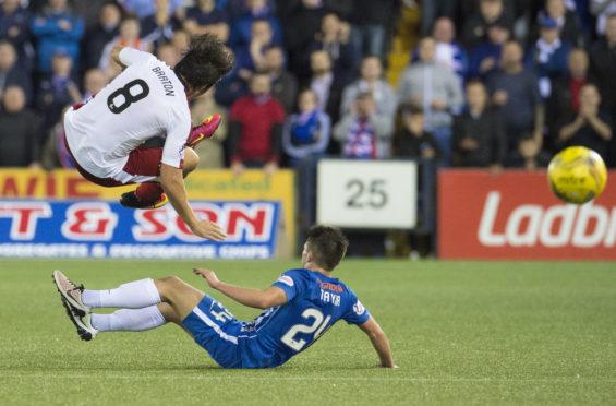 Kilmarnock's Greg Taylor  tackles Joey Barton