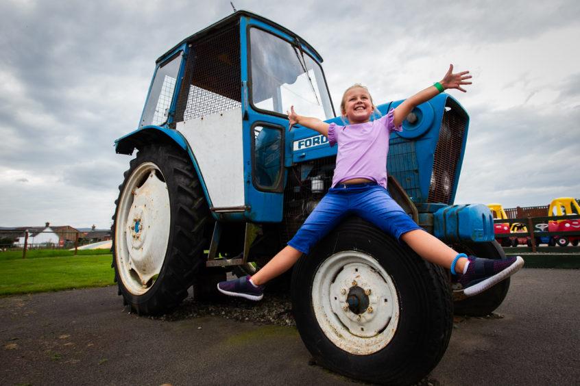 Erin Bentley, 8, from Leeds enjoying the farm