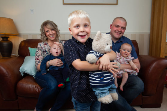 Heather Goring at home with husband Colin, sons David and Nathan and daughter Grace