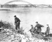Four British paratroopers who were captured on the last outpost on Arnhem Bridge and taken captives to Germany are shown, as they later escaped through a German town and woods, to reach Nijmegen and the British Second Army after rowing across the Rhine in a boat they found