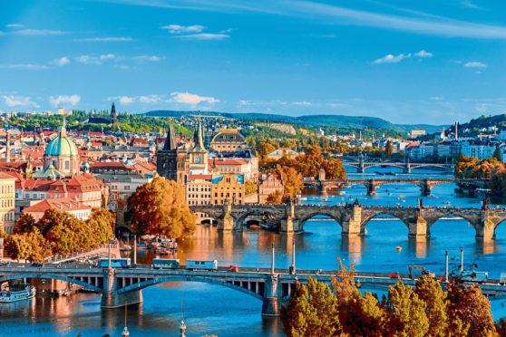 Prague View of the Vltava River and Charle bridge with red foliage, Prague, Czech Republic