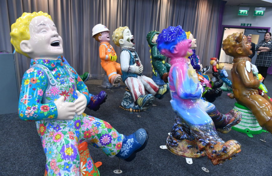 Oor Wullie statues patiently waiting in the wings ahead of their auction at Thainstone in Inverurie on Tuesday night.